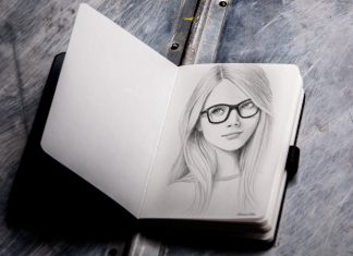 Free-Photorealistic-Sketchbook-Mockup-PSD