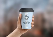 Free-Coffee-Paper-Cup-in-Hand-Mockup-PSD-2