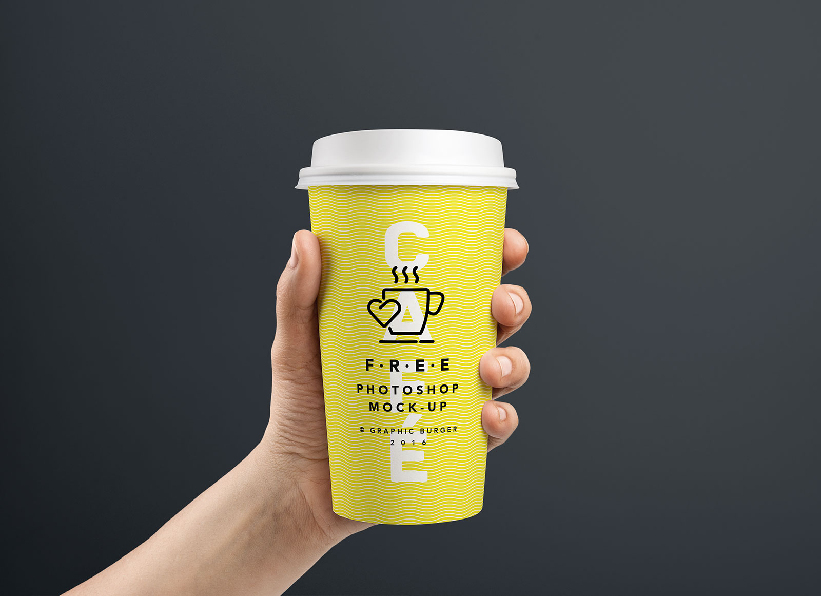 Free Coffee Paper Cup in Hand Mockup PSD - Good Mockups