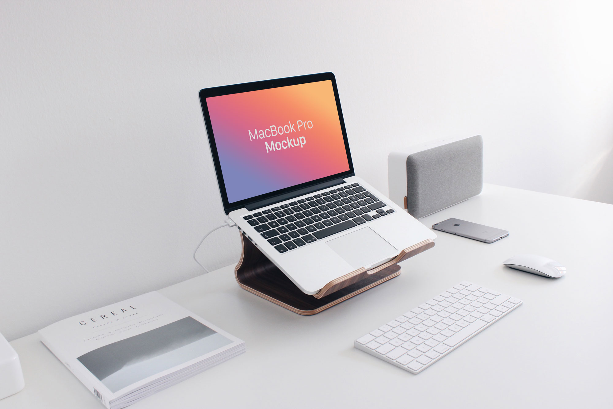 Free-MacBook-Pro-Workplace-Photo-Mockup-PSD