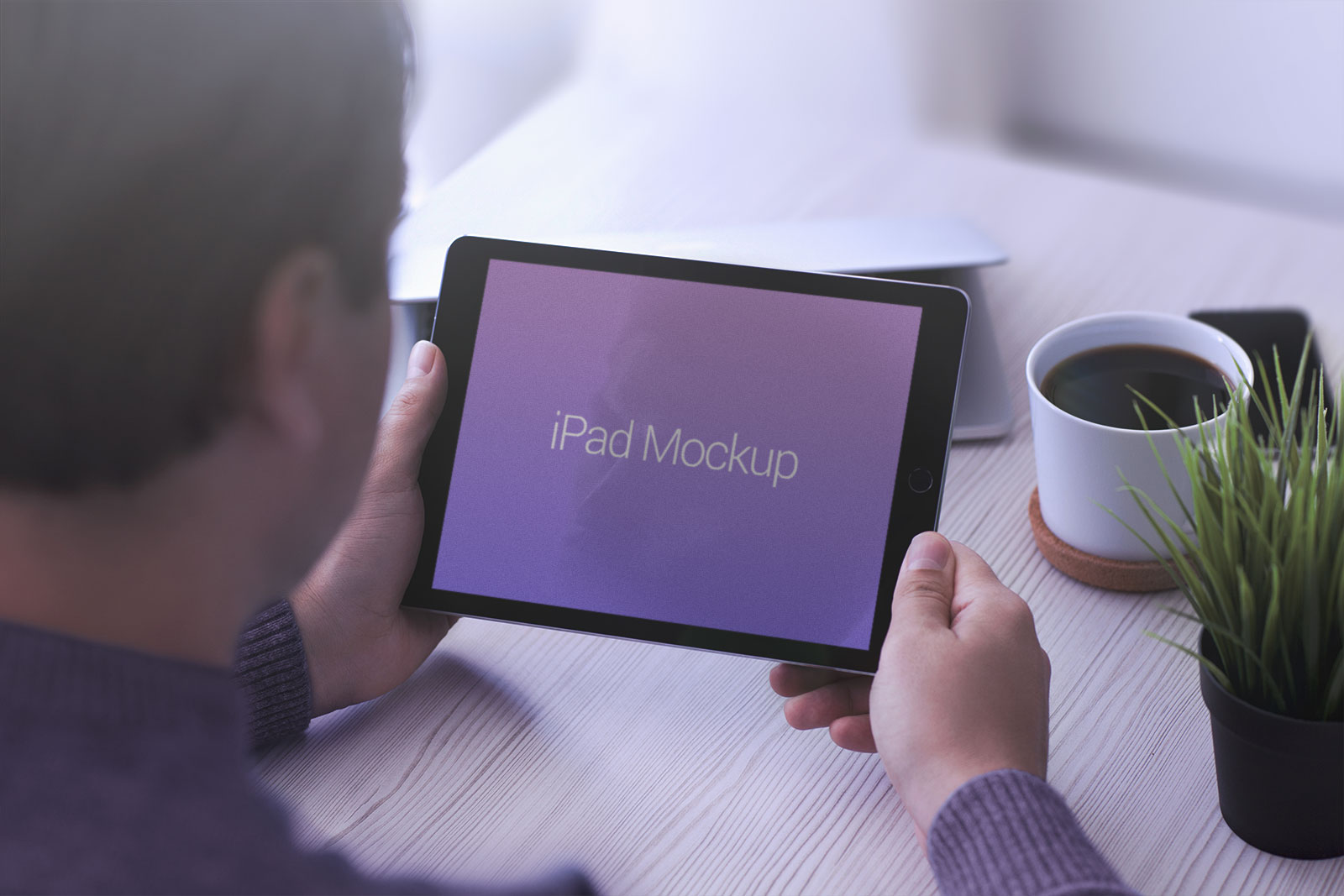 Free-Apple-iPad-in-Hand-Photo-Mockup-PSD-2