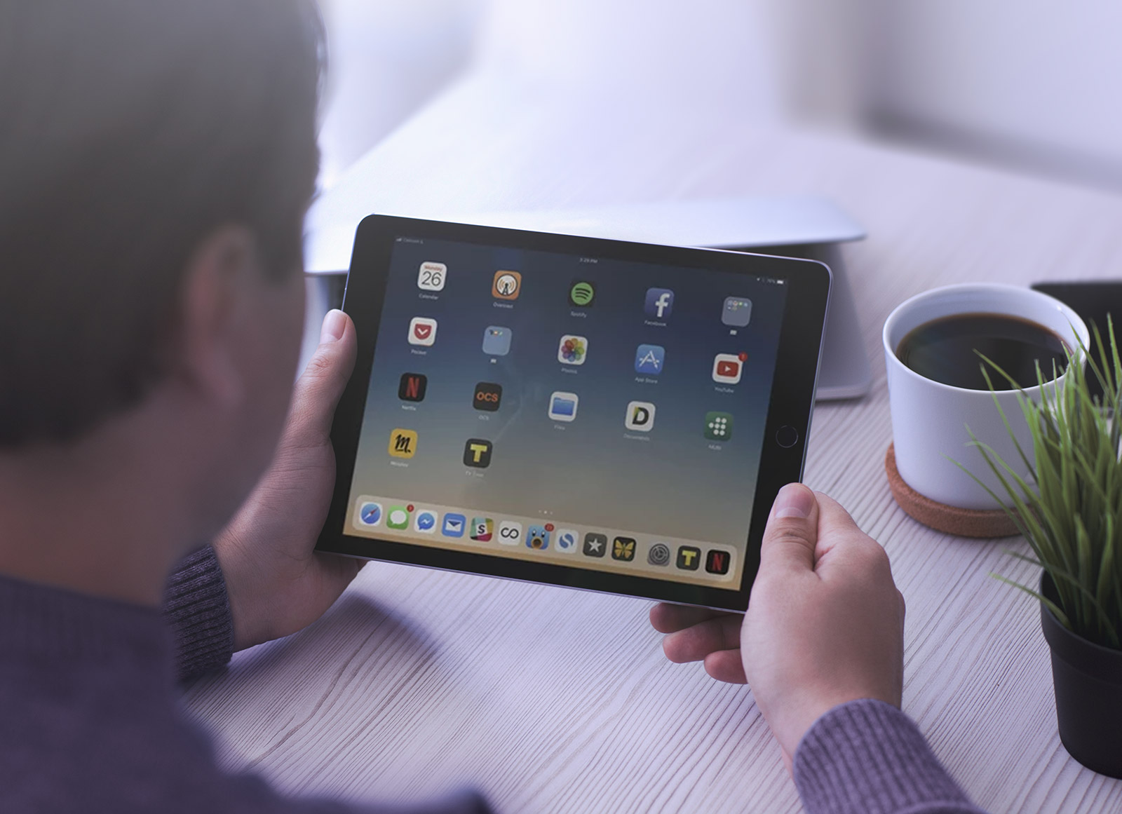 Free-Apple-iPad-in-Hand-Photo-Mockup-PSD