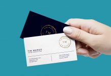 Free-Female-Hand-Holding-Business-Card-Mockup-PSD