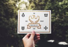 Free-Hand-Holding-Greeting-Card-Mockup-PSD
