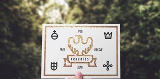 Free-Hand-Holding-Greeting-Card-Mockup-PSD
