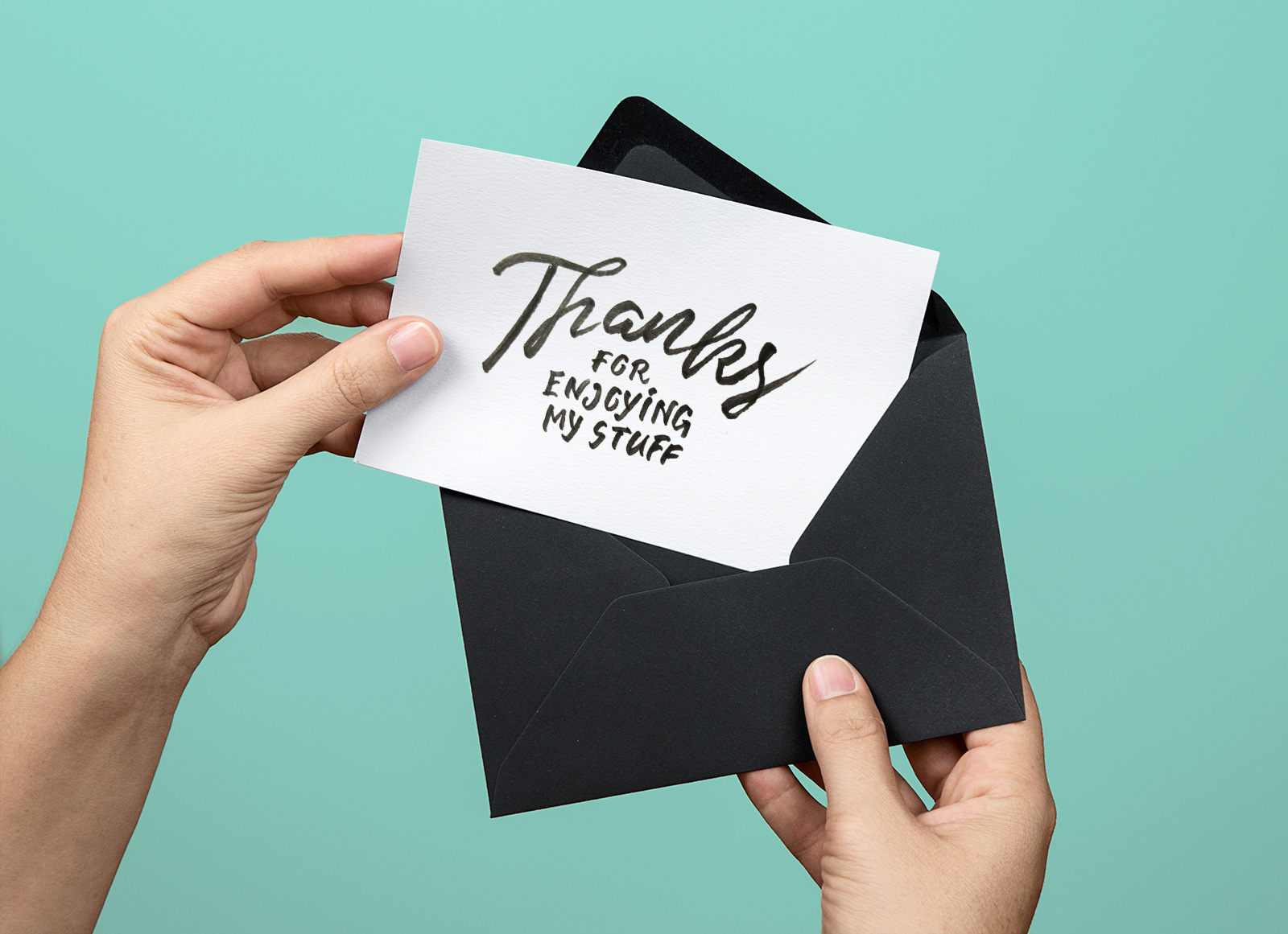 Free-Hand-Holding-Greeting-Card-PSD-Mockup-2