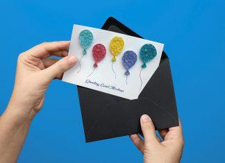 Free-Hand-Holding-Greeting-Card-PSD-Mockup