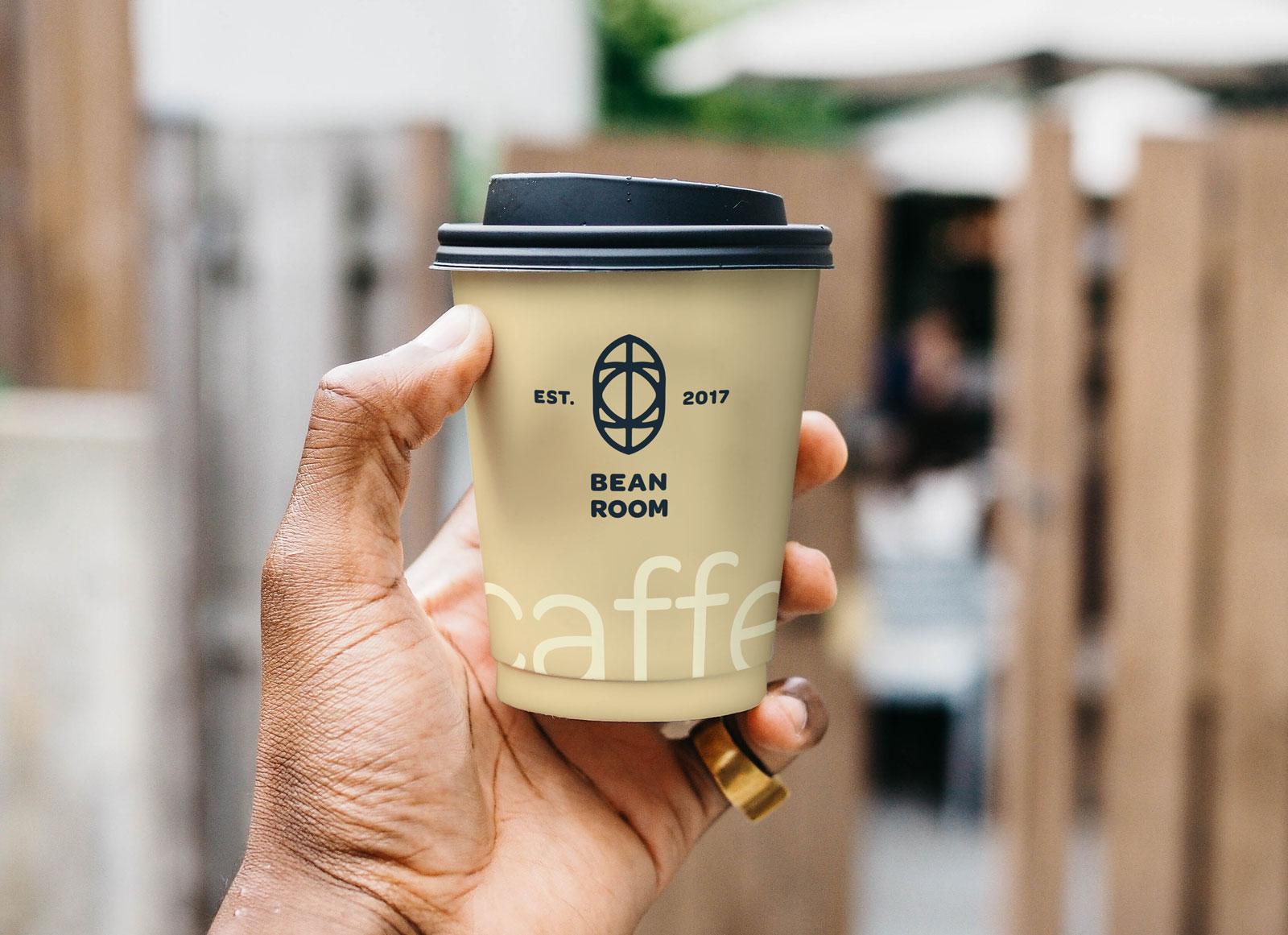 Free-Hand-Holding-Coffee-Cup-Photo-Mockup-PSD