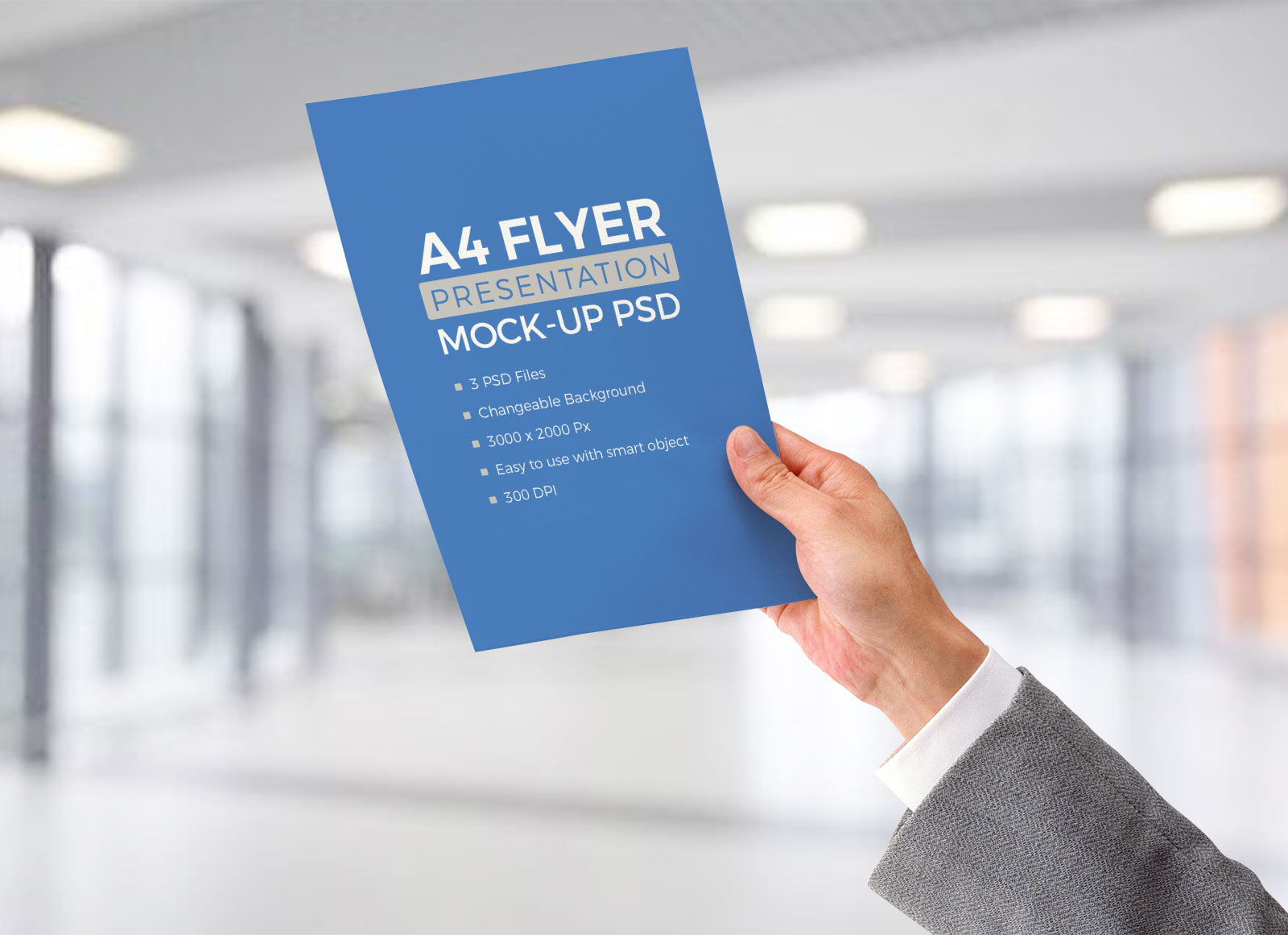 free a4 resume   flyer in male hand mockup psd