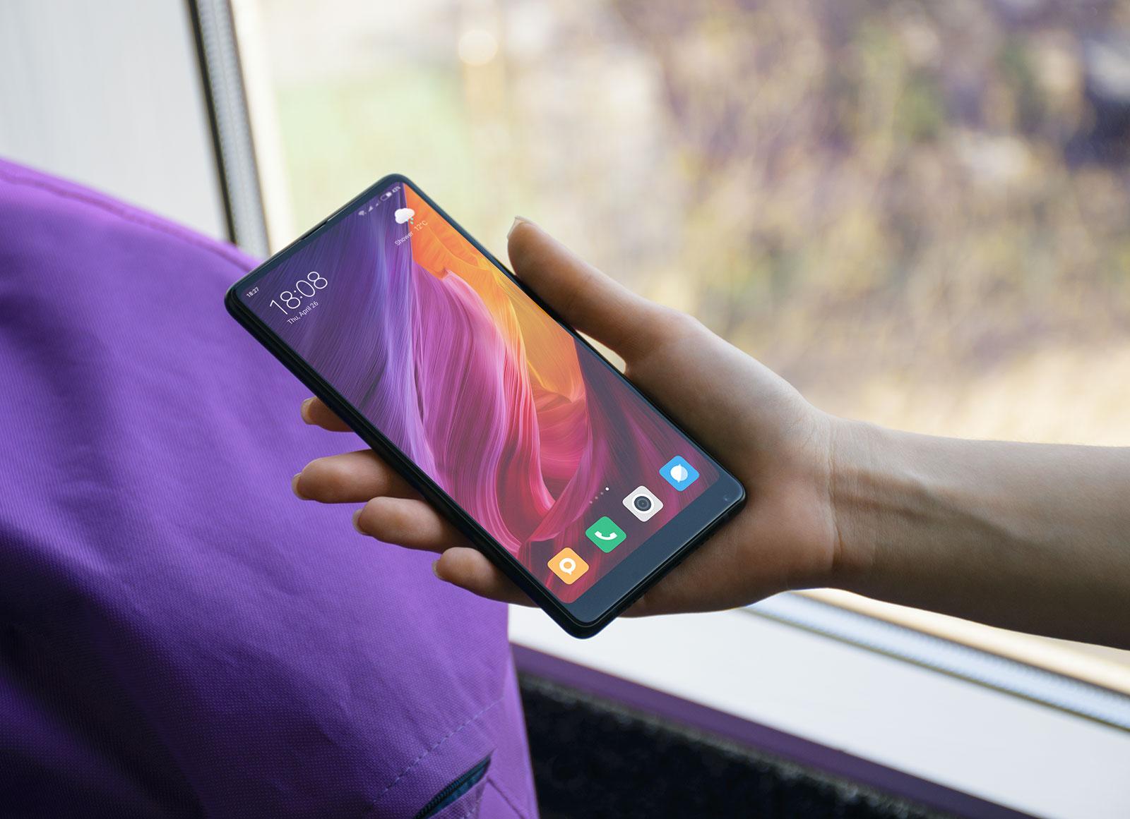 Free-Xiaomi-Mi-Mix-2-Mobile-Phone-in-Female-Hand-Mockup-PSD-4