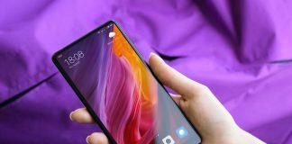 Free-Xiaomi-Mi-Mix-2-Mobile-Phone-in-Female-Hand-Mockup-PSD-5