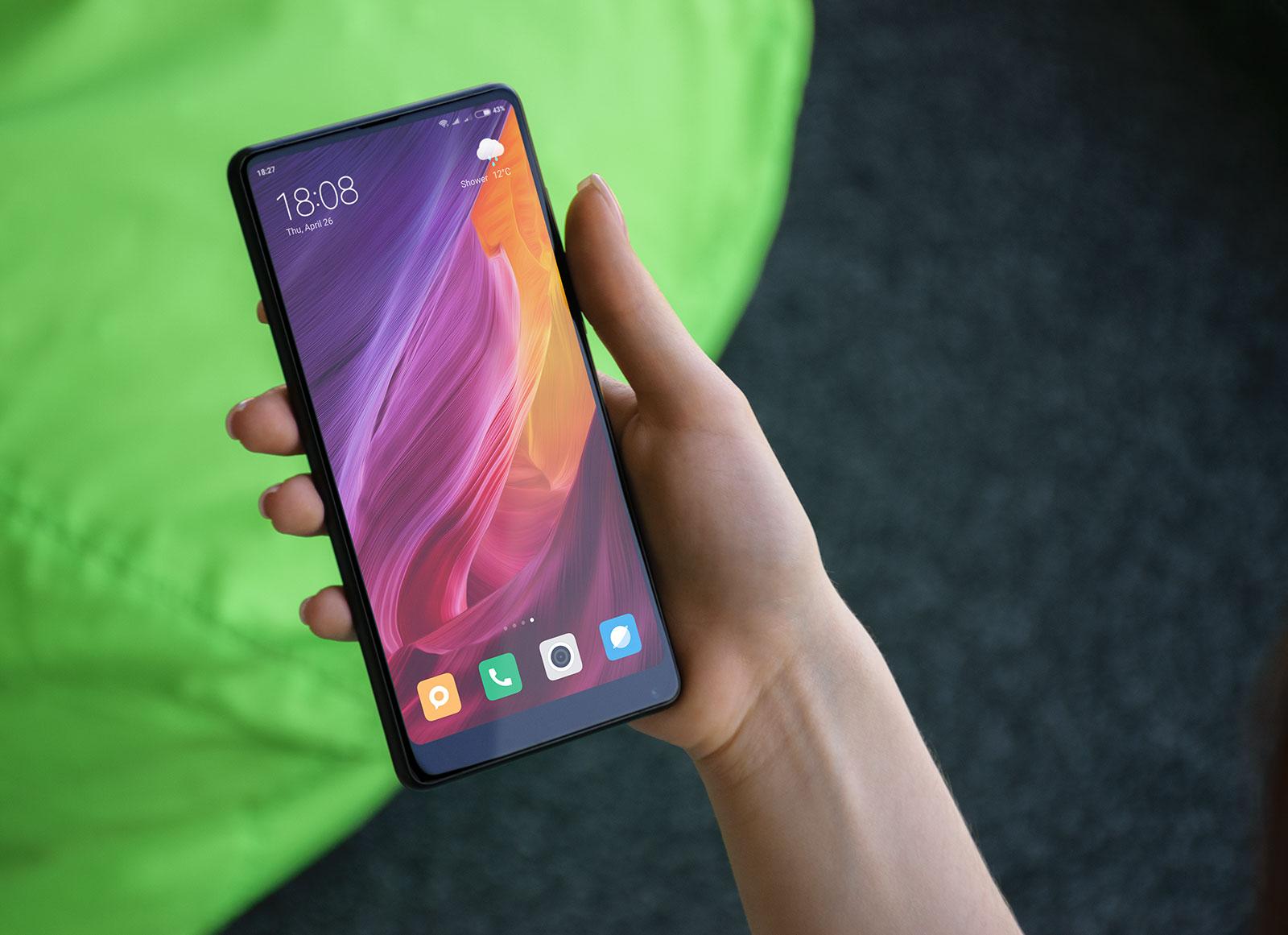 Free-Xiaomi-Mi-Mix-2-Mobile-Phone-in-Female-Hand-Mockup-PSD