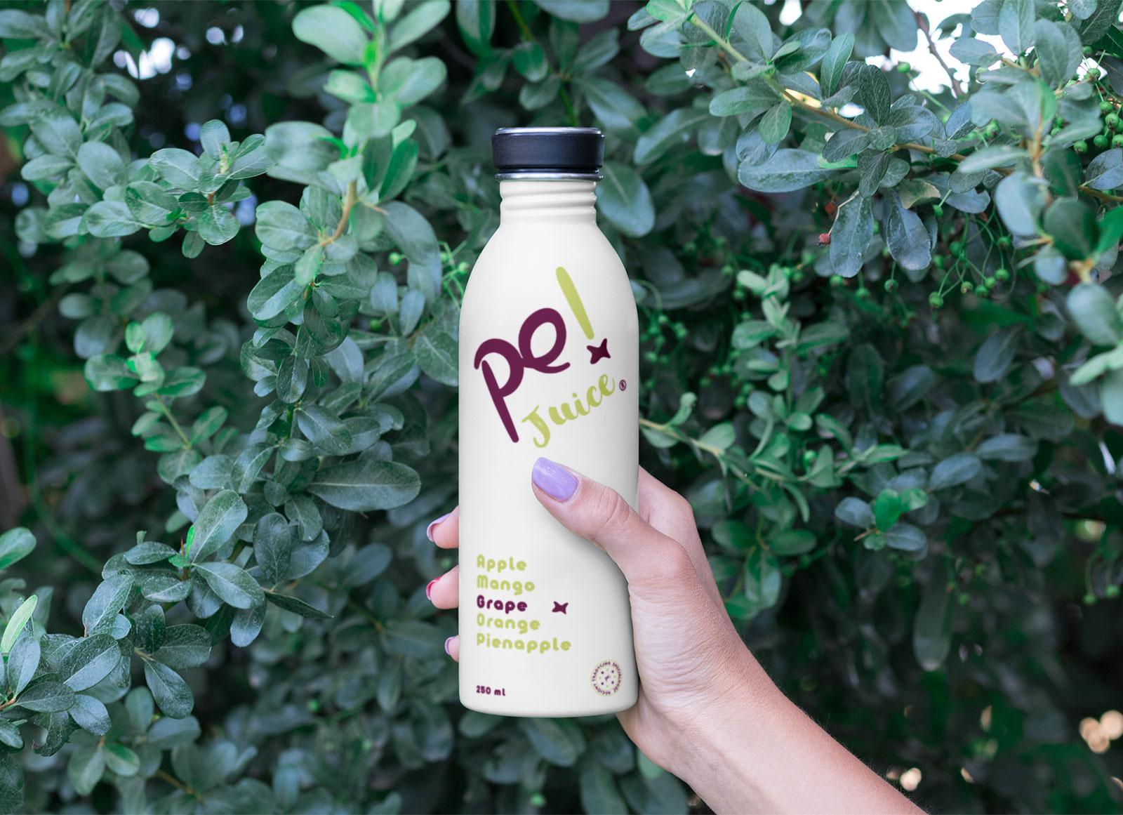 Free-Hand-Holding-Juice-Bottle-Mockup-PSD