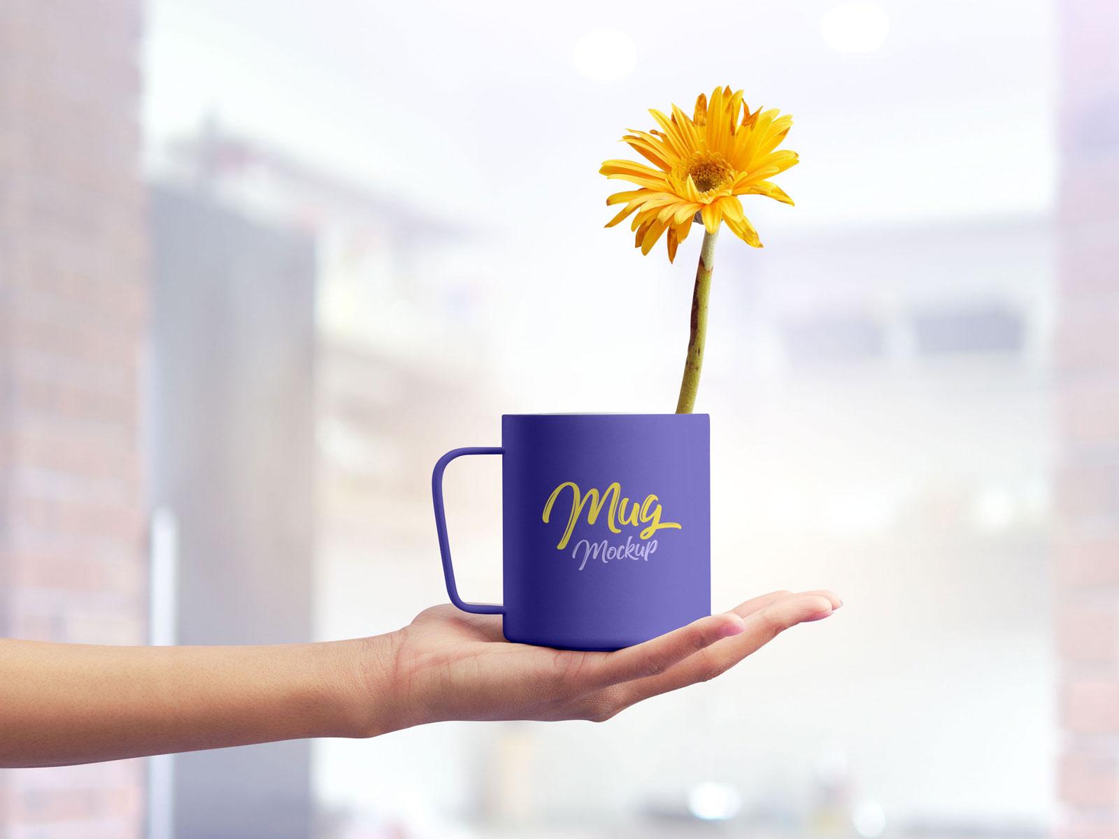 Free-Mug-on-Female-Hand-Mockup-PSD-2