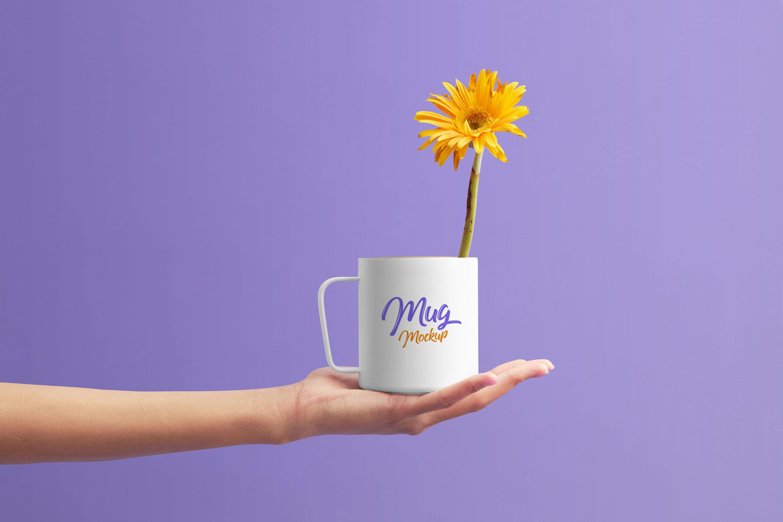 Free-Mug-on-Female-Hand-Mockup-PSD