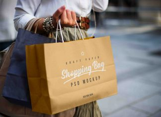 Free-Female-Holding-Kraft-Paper-Shopping-Bag-Mockup-PSD