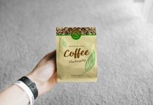 Free-Hand-Holding-Coffee-Packaging-Mockup-PSD