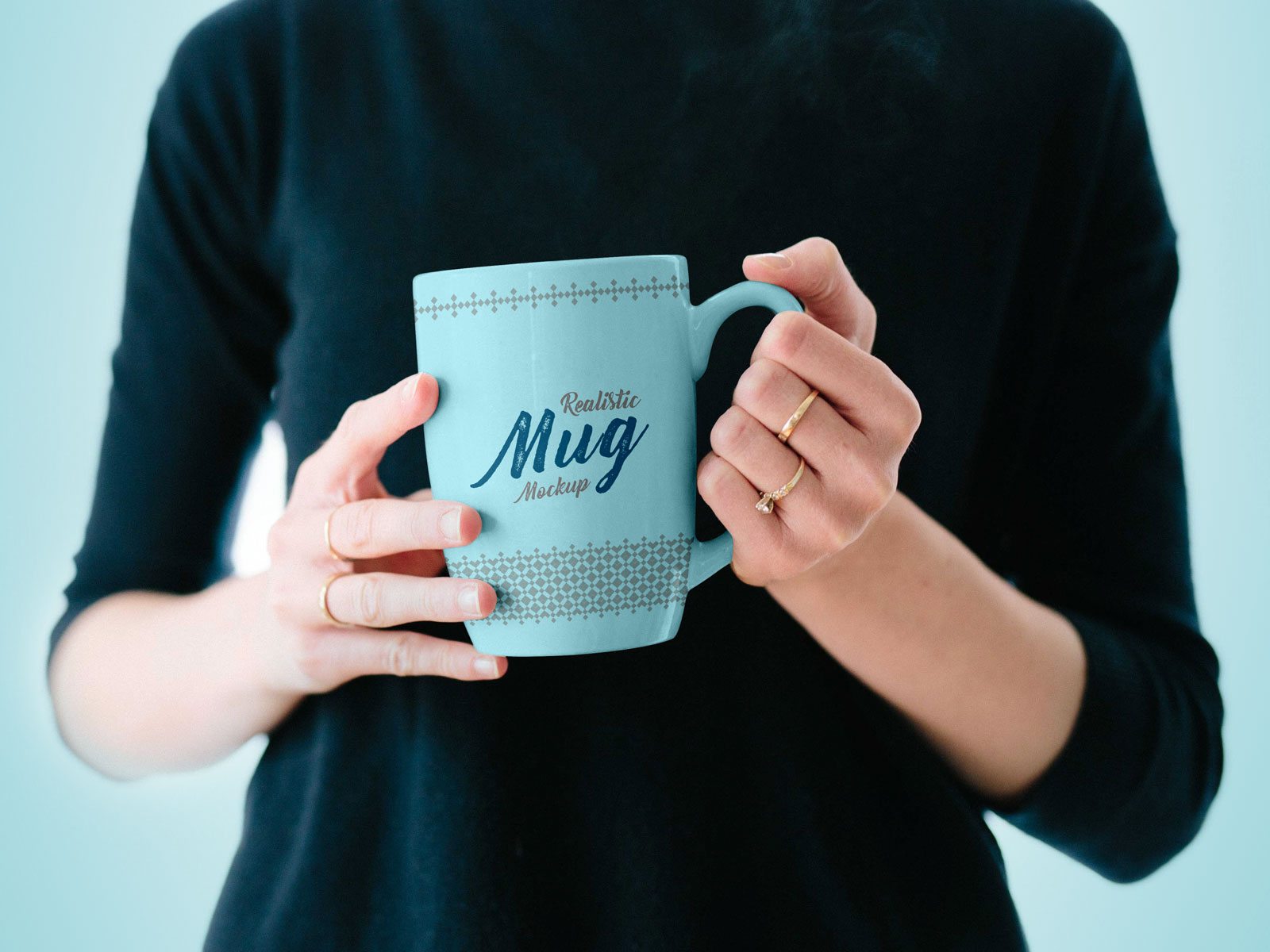 Free-Mug-in-Female-Hand-Mockup-PSD-1
