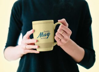Free-Mug-in-Female-Hand-Mockup-PSD-2