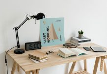 Free-Poster-on-Workplace-Mockup-PSD