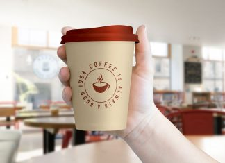 Free-Hand-Holding-Coffee-Cup-Mockup-PSD-File