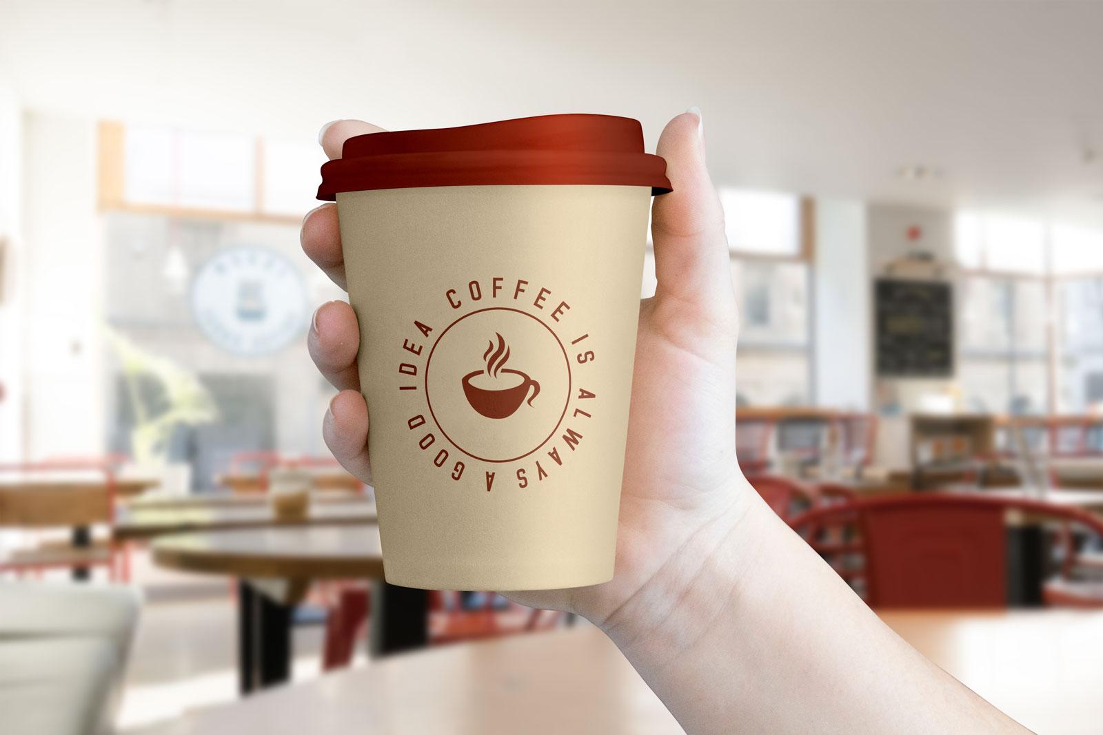 Free-Hand-Holding-Coffee-Cup-Mockup-PSD-File