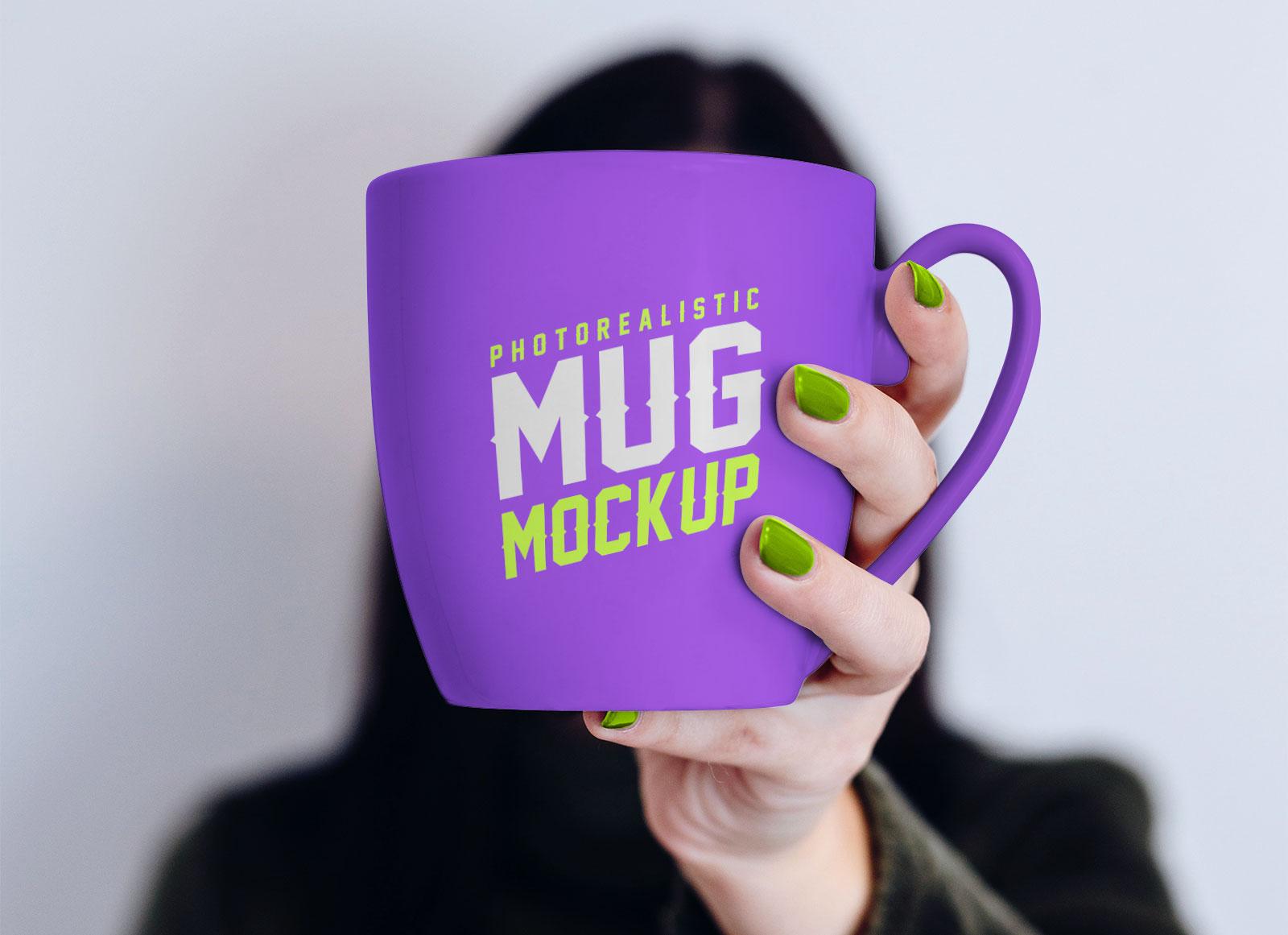 Free-Mug-in-Female-Hand-Mockup-PSD-2