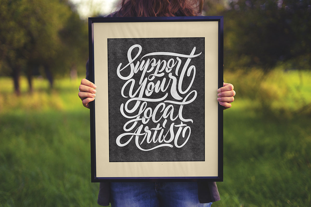 Free-Hand-Holding-Poster-Frame-Mockup-PSD