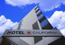 Free-Hotel-Entrance-Fascia-Board-Logo-Mockup-PSD
