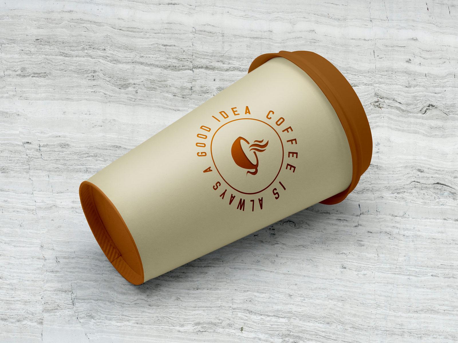 Free-Coffee-Cup-Lying-on-Floor-Mockup-PSD