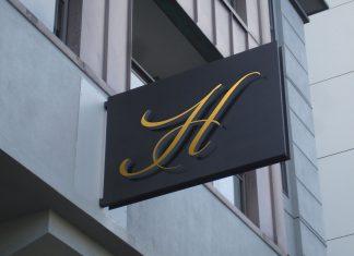 Free-Hotel-Wall-Mounted-Signage-Mockup-PSD