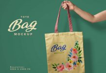 Free-Hand-Holding-Tote-Bag-Mockup-PSD