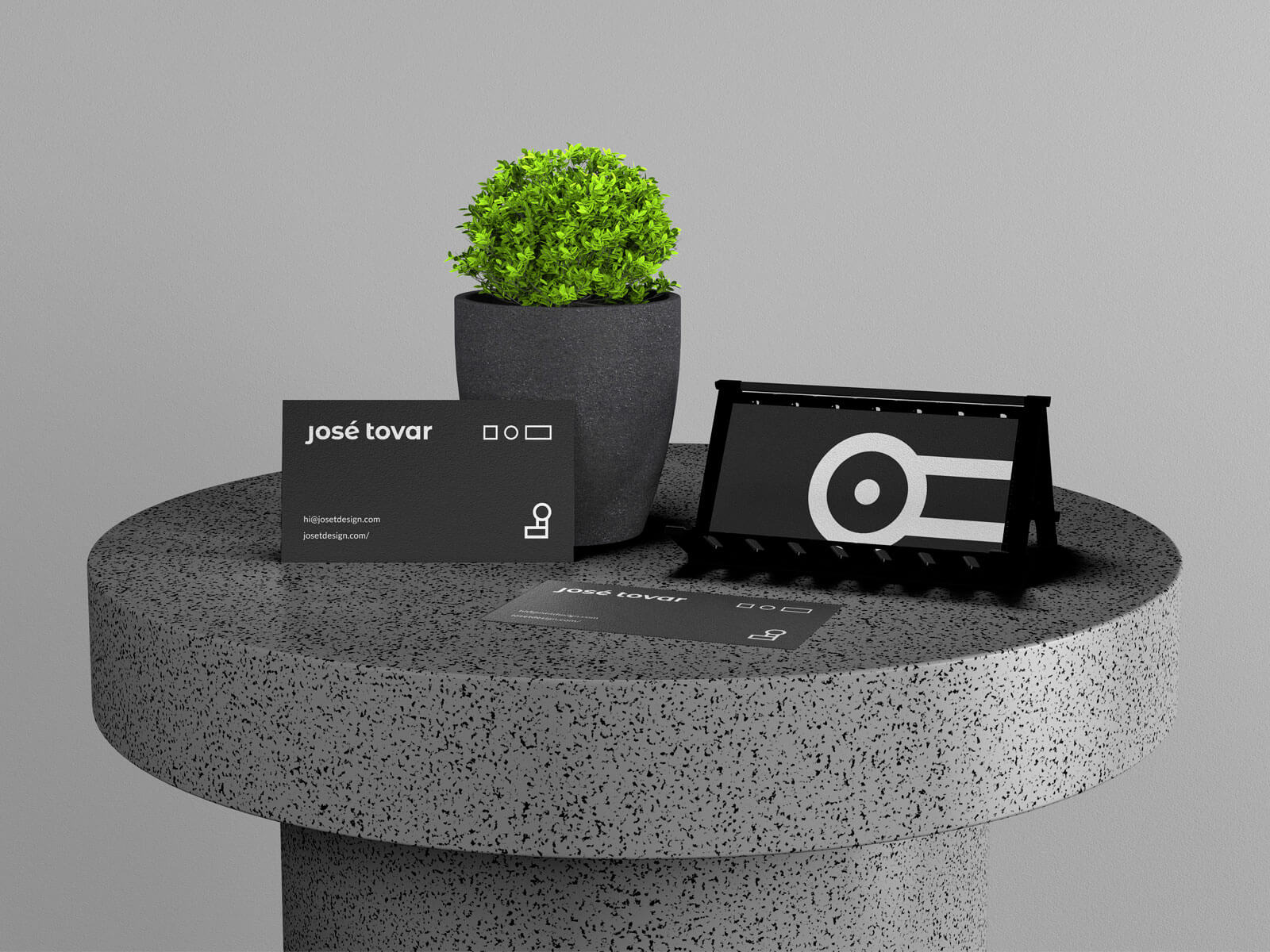 Free-Business-Card-Stand-On-Table-Mockup-PSD-File