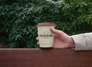 Free Hand Holding Small Paper Coffee Cup Mockup PSD