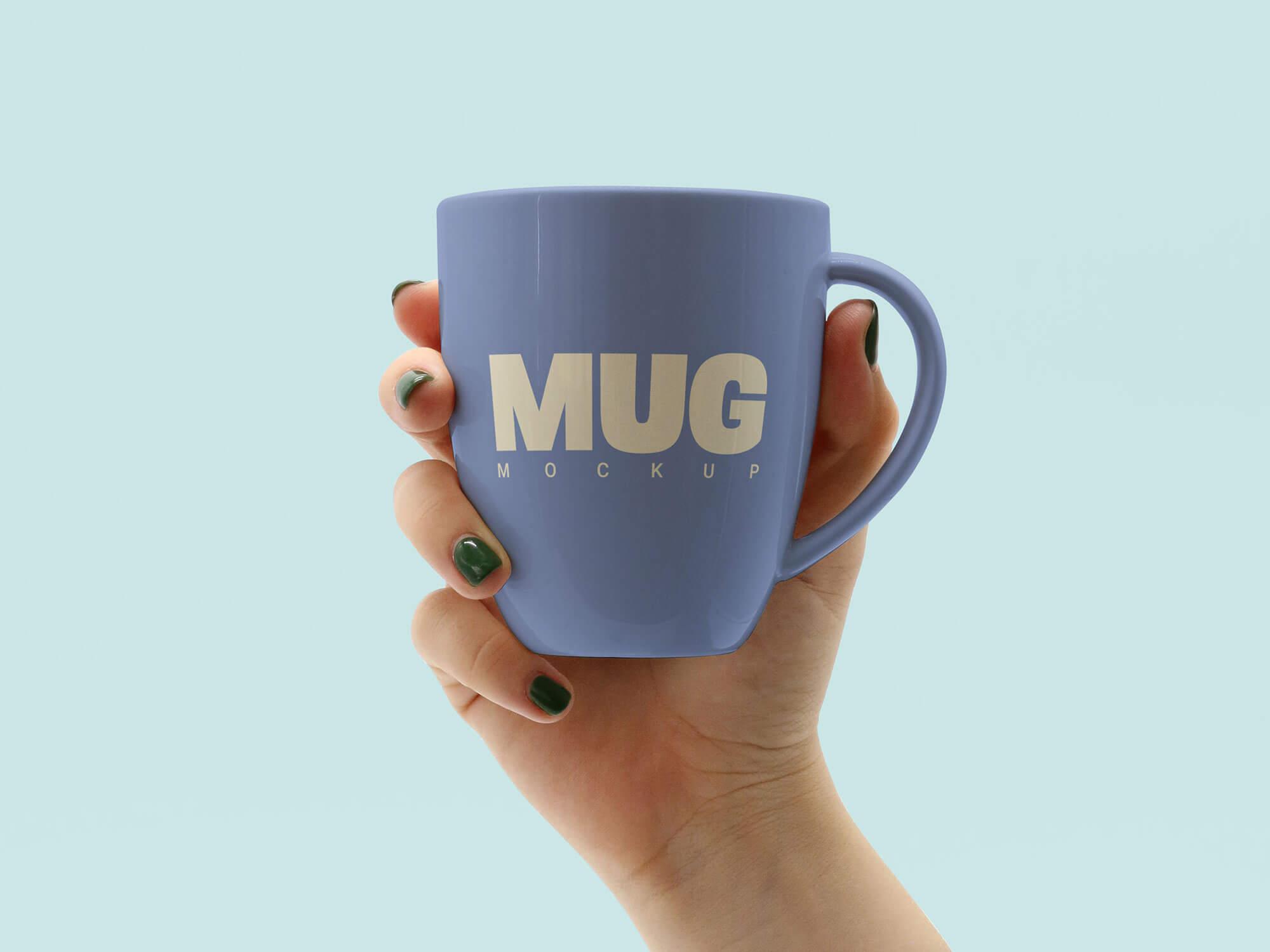 Free-Hand-Holding-Mug-Mockup-PSD-File