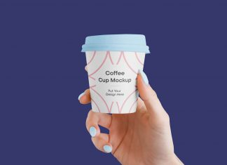 Free-Hand-Holding-Small-Coffee-Cup-Mockup-PSD