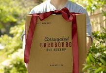 Free-Hand-Holding-Corrugated-Cardboard-Box-Mockup-PSD