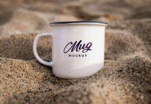 Free-Mug-in-Sand-Mockup-PSD