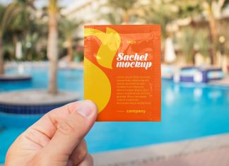 Free-Hand-Holding-Sachet-Mockup-PSD