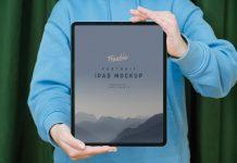 Free-Hand-Holding-iPad-Pro-Mockup-PSD